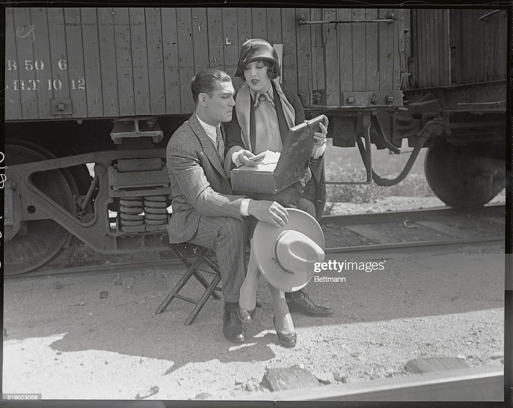 Jack Dempsey with Wife in his Lap : News Photo