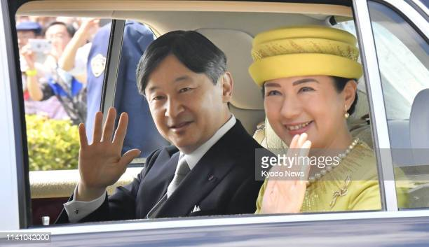 Photo shows Japanese Emperor Naruhito and Empress Masako en route to the Imperial Palace in Tokyo on May 4 to greet wellwishers for the first time...