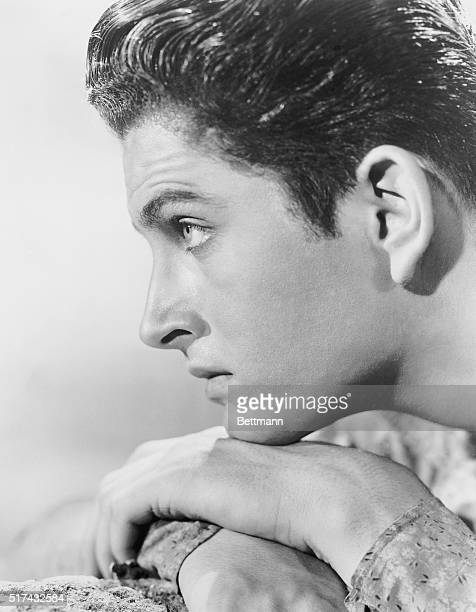 Photo shows John Barrymore Jr in a posed closeup publicity handout head resting on his hands in this profile shot Ca 1900s1920s