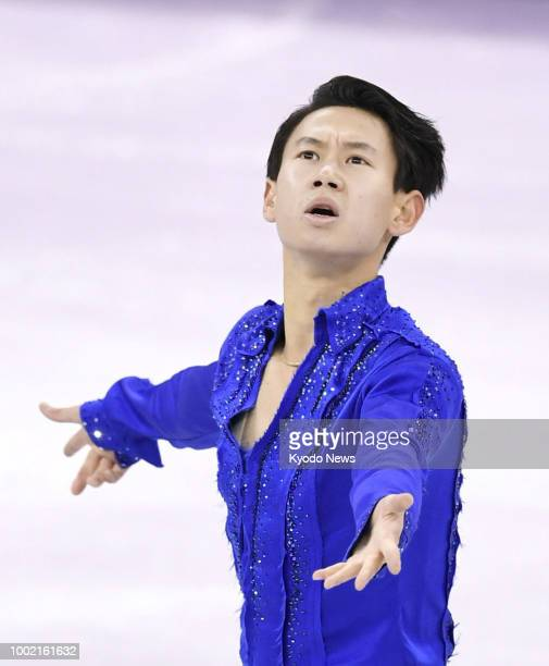 Photo shows Kazakh figure skater and 2014 Olympic bronze medalist Denis Ten performing during the Pyeongchang Winter Olympics in South Korea in...
