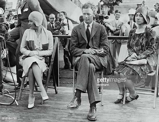 Photo shows left to right Gloria Swanson Colonel Charles A Lindbergh and his wife seated on the platform during the ceremony that marked the arrival...