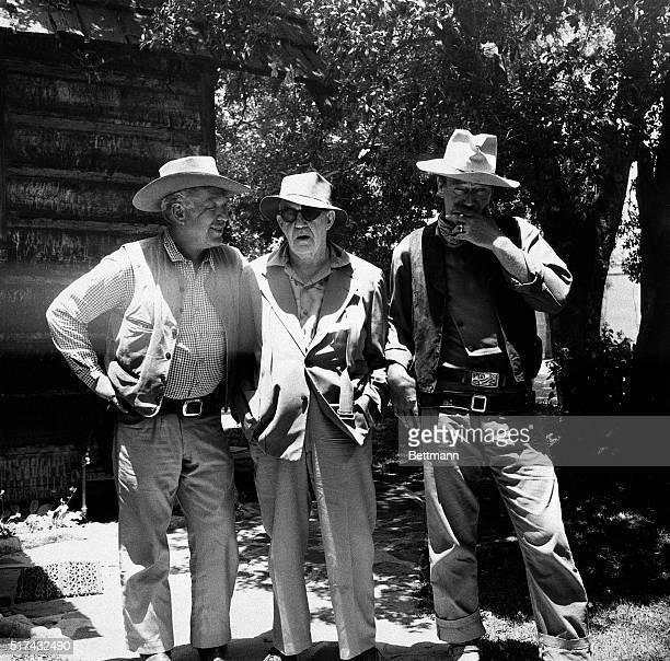 Photo shows left to right Ward Bond Director John Ford and John Wayne Undated photo