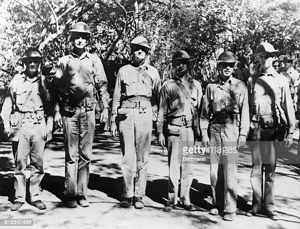 Photo shows Marine Corps officers as they marched along a jungle road in the Philippines after the 4th Marine Regiment had landed there prior to the...