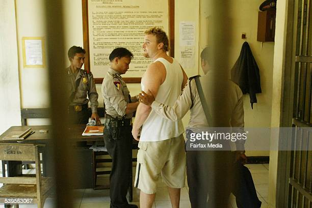 Photo shows Martin Stephens from Wollongong being led by police to meet his parents at Denpasar's police headquarters 23 April 2005 SHD Picture by...