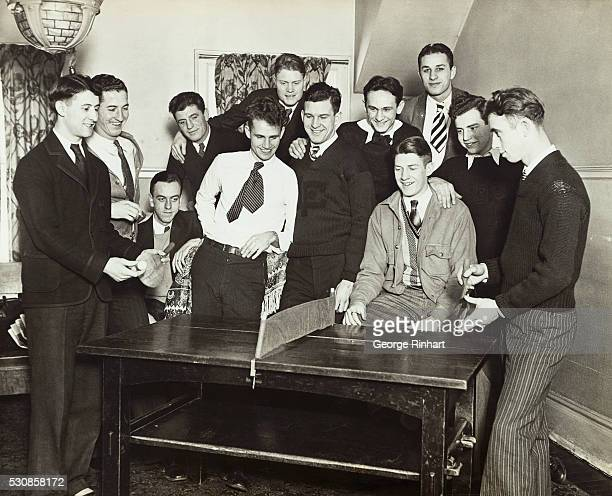 Photo shows members of the Lake Forest College football squad who indulge in the game of PingPong during the winter time after a strenuous season on...