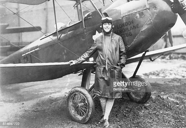 Photo shows Miss Amy Johnson the young Yorkshire air woman beside her plane at Croyden Airport England Filed May 13th 1930