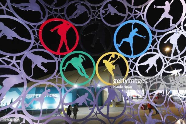 Photo shows monuments illuminated at Olympic Park in Gangneung South Korea on Feb 8 the eve of the opening ceremony of the Pyeongchang Winter...