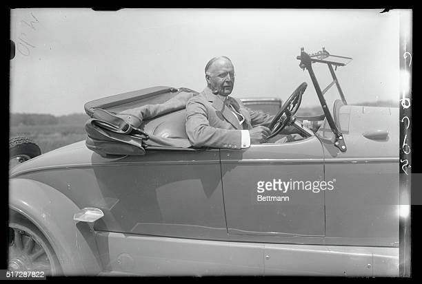 Photo shows Mr. T. Suffern Taylor of New York at the wheel of his new Lincoln right hand drive roadster the first right hand drive Lincooln to be...