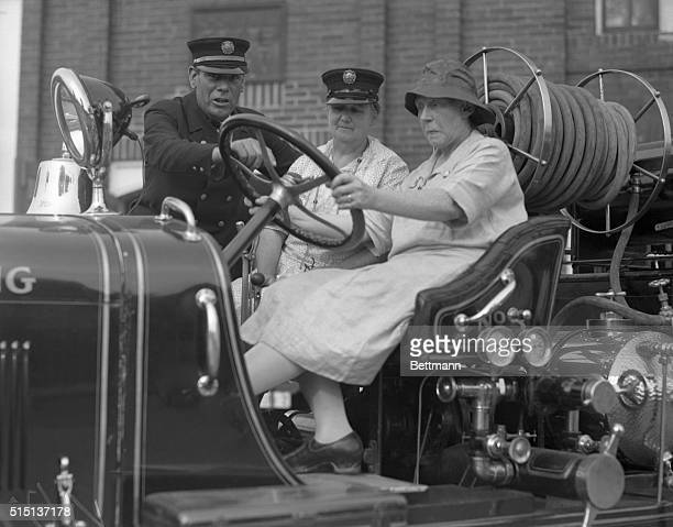 Photo shows Mrs May Cissell chief of the women's fire department of Silver Springs Maryland with Mrs Richard James The women have formed their own...