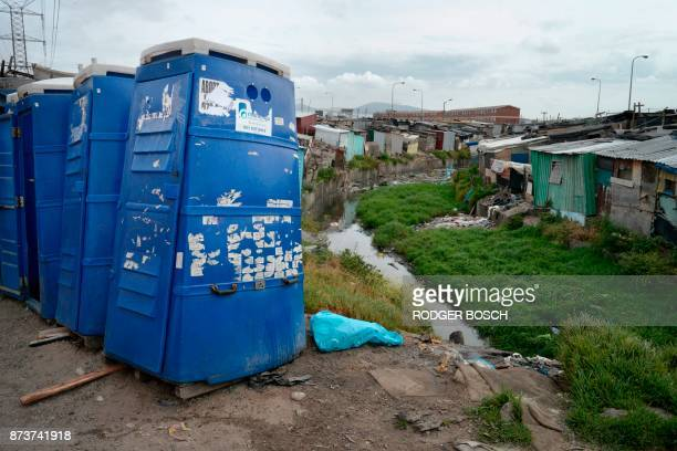 A photo shows portable toilets near a polluted canal in an informal settlement in Langa a mostly impoverished township about 10km from the centre of...