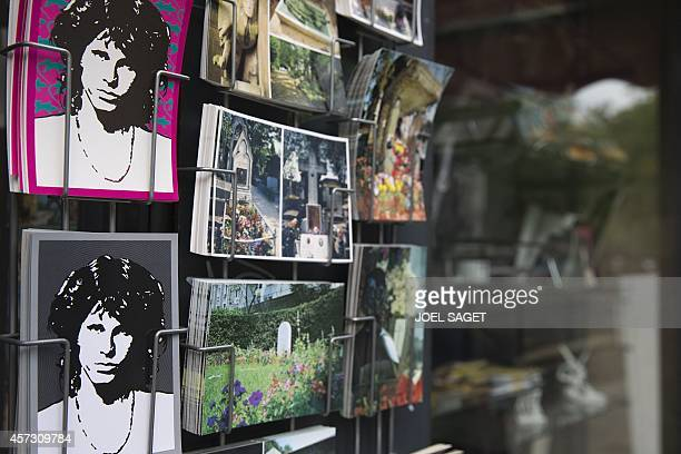 A photo shows postcards displaying pictures of late US singer Jim Morrison in a souvenirs shop at the Pere Lachaise cemetery in Paris on October 16...
