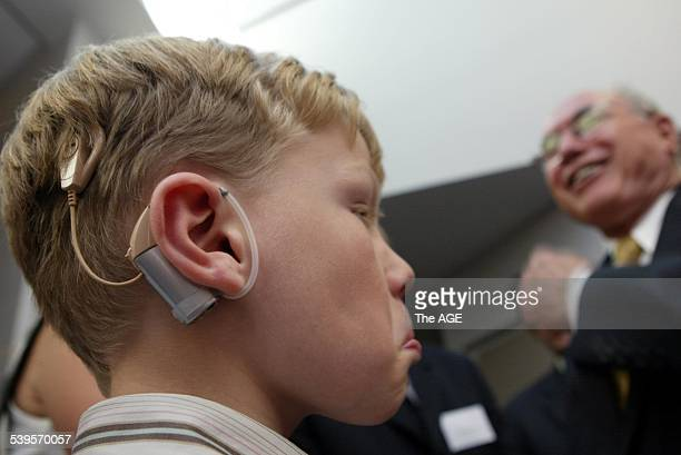 COCHLEAR IMPLANTS Photo shows Prime Minister John Howard at the 20th anniversary of the first Cochlear implants Institute in Melbourne on 11th April...