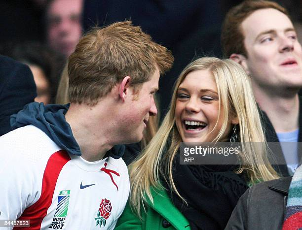 Photo shows Prince Harry and his girlfriend Chelsy Davy laughing before the Investec Challenge international rugby match South Africa vs England in...