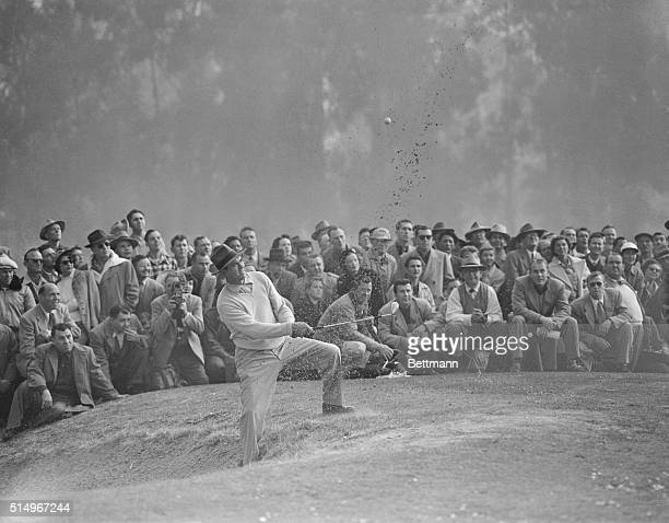 Photo shows Sammy Snead as he blasts out of a sand trap on the fourth hole in a playoff today with mighty Ben Hogan for title in Los Angeles Open...
