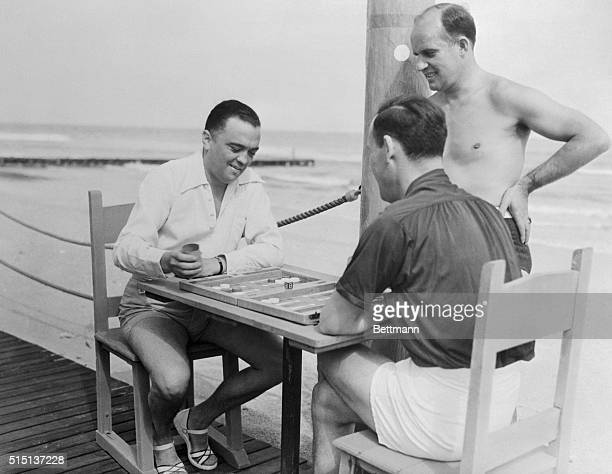 Photo shows some of the Federal Agents who are in Miami, Florida, to set up a new bureau of the department as they recently relaxed in the sun, while...