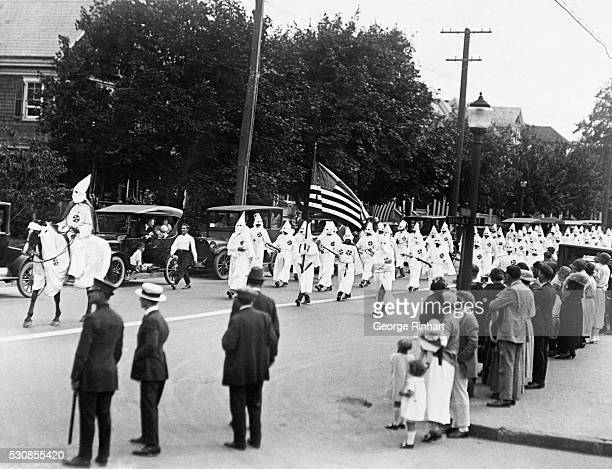 Photo shows some of the four thousand Klansmen that marched in the parade down Broadway Long Branch yesterday The parade was viewed in silence by...