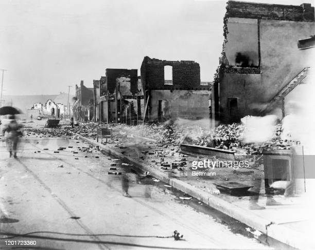 Photo shows the aftermath, at east corner of Greenwood Avenue and East Archer Street, of the Tulsa Race Massacre, during which mobs of white...