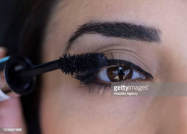 A photo shows the closeup brown eye of a woman getting her eyelashes makeup using mascara at a makeup and cosmetic products shop in Ankara Turkey on...