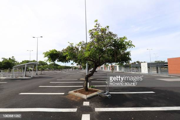 A photo shows the empty parking lot of a supermarket on the fourth day of protest of the socalled yellow vest movement against high fuel prices in...