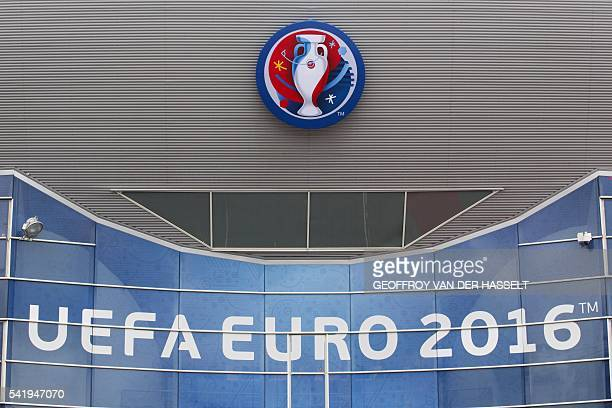 A photo shows the Euro logo outside the Parc des Princes stadium in Paris on June 21 2016 ahead of the Euro 2016 group C football match between...