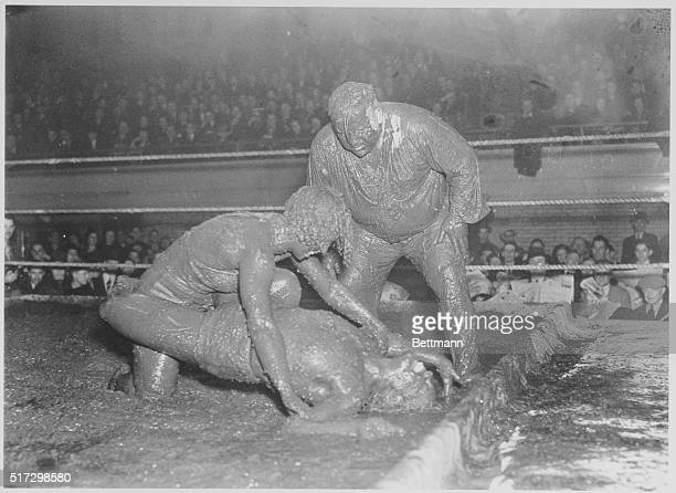 Photo shows the extremes wrestlers will go to make an honest dollar Holds may be weird and varied but the substances to wrestlers try to pin each...