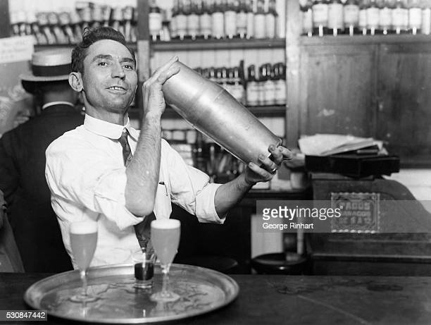Photo shows the famous Sloppy Joe with his one gallon cocktail shaker He is known the world over