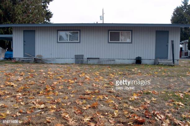 Photo shows the house in Tacoma, Washington on 24 October 2002 where tree stumps were removed for evidence in an unfolding investigation of accused...