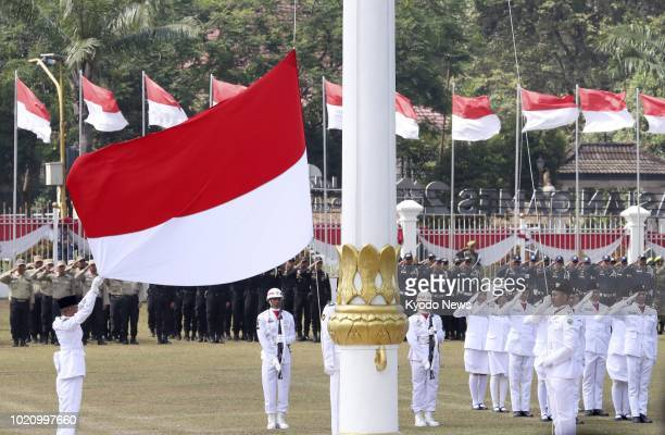 Photo shows the Indonesian flag being raised at a government facility in Palembang South Sumatra on Aug 17 the country's 73rd Independence Day ==Kyodo