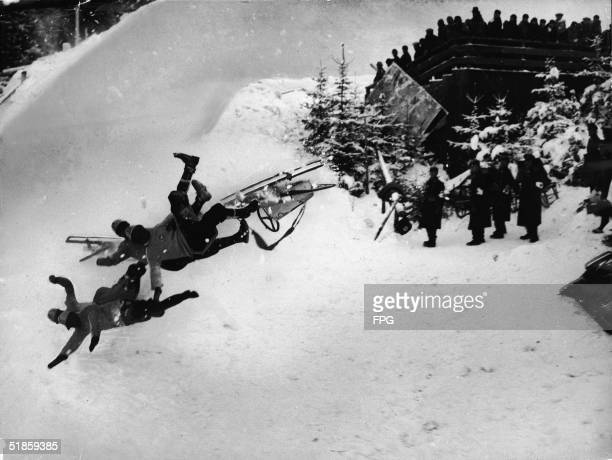 Photo shows the Italian Olympic bobsled 'Italia 2' as it hurtles through the air on the 'Bayern' curve and tosses its crew of Francesco de Zanna...