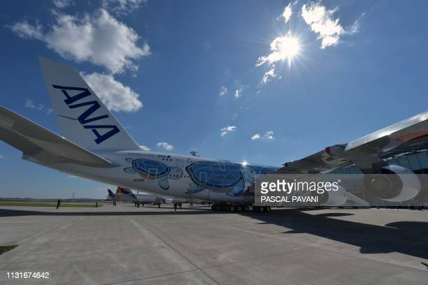 A photo shows the Japanese airline All Nippon Airways ANA Airbus A380 during a ceremony for the delivery of the company's first Airbus A380 on March...