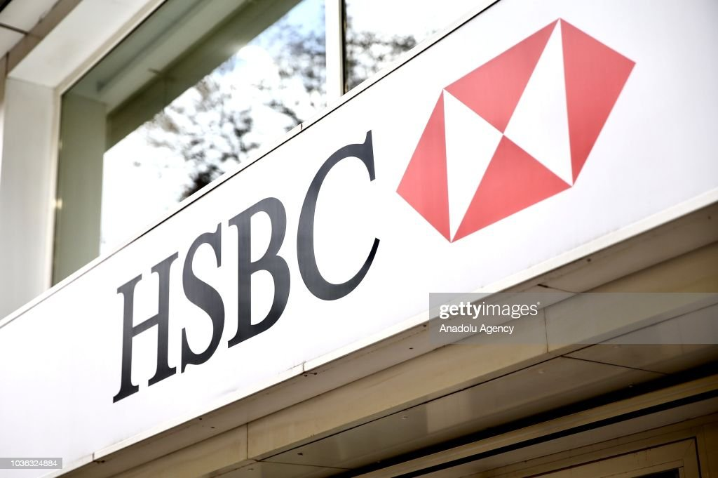 A photo shows the logo and bank sign board of 'HSBC' in