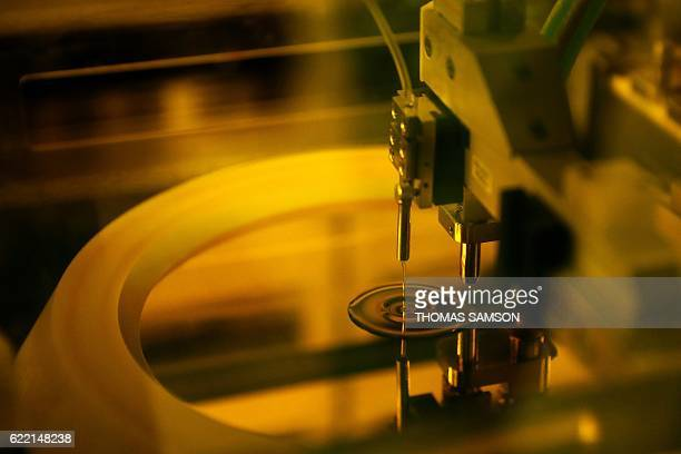 A photo shows the process of manufacturing of electronic chips in the XFab semiconductors factory in Ormoy near Paris on November 10 2016 / AFP /...
