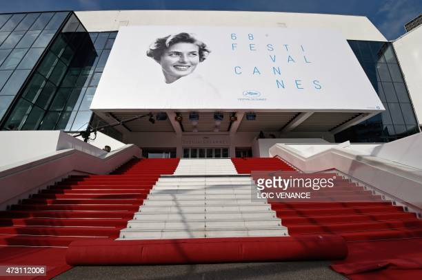 A photo shows the red carpet being prepared at the Festival palace ahead of the opening of the 68th Cannes Film Festival in Cannes southeastern...