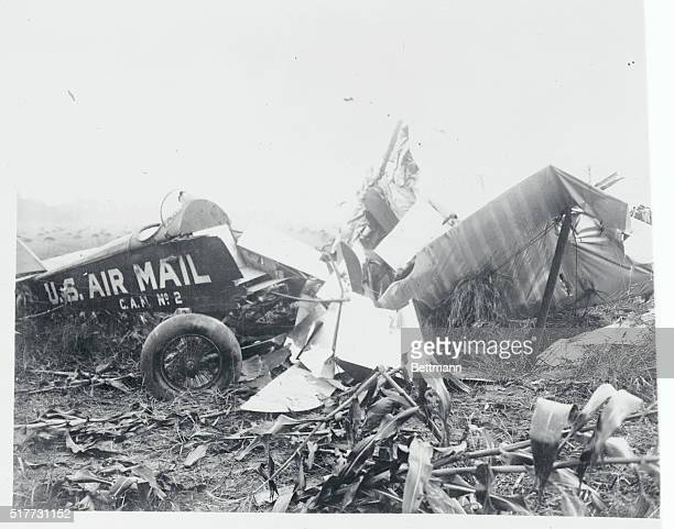 Photo shows the remains of the airmail plane flown by Charles Lindbergh when he ran out of gas and climbed to 5000 feet to only have to jump with his...