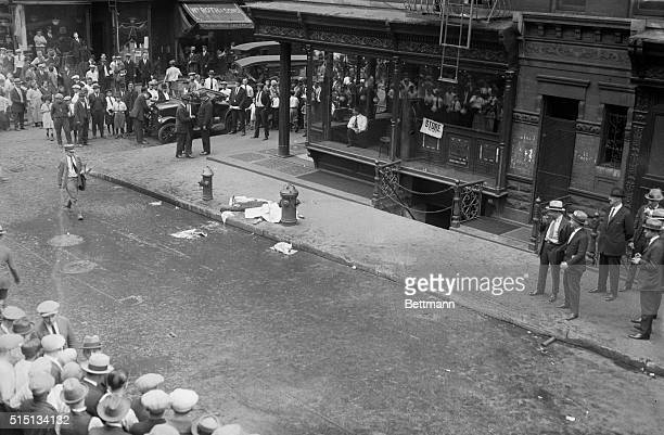 Photo shows the scene of the newest tong murder on Mott Street New York with the body of the victim lying on the sidewalk Despite rumored peace...