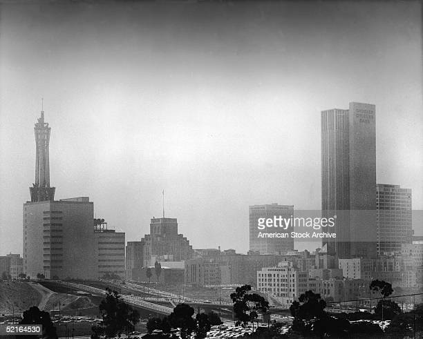 Photo shows the skyline of downtown Los Angeles including the PacBell building One Bunker Hill the City National Bank building the Crocker Citizen's...