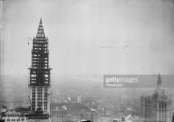 Photo shows the tower construction for the Woolworth Building on Broadway New York New York 1912 On the right is the Municipal Building also under...