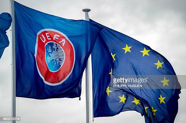 Photo shows the UEFA flag flying next to the European Union flag on December 11 in Comines-Warneton during the inauguration of a monument to...