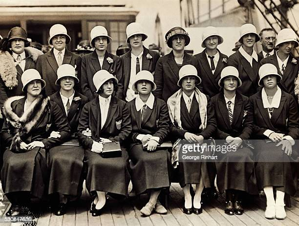 Photo shows the US Olympic Girl's Swimming Team on the deck of the SS America as they sailed for France and the 1924 World's Championships Left to...