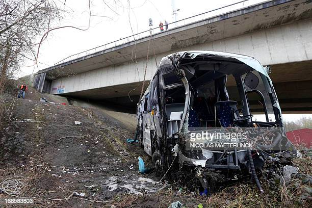 Photo shows the wreckage after a bus crashed off the E34 highway near Ranst, Antwerp province, on April 14, 2013. At least five people died and...