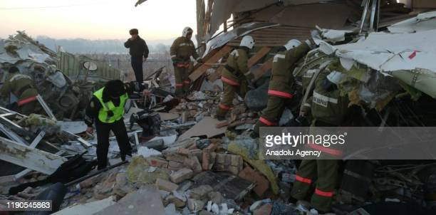 Photo shows the wreckage of a passenger plane after it crashed on December 27, 2019 in Almaty, Kazakhstan. At least nine people were killed and nine...
