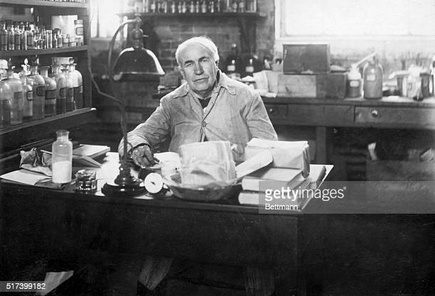 Photo shows Thomas Edison seated at his desk in a chemical laboratory Undated