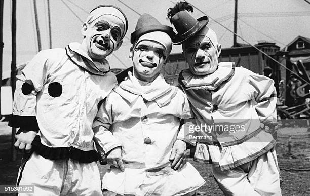 Photo shows three midget clowns in full clown garb Undated