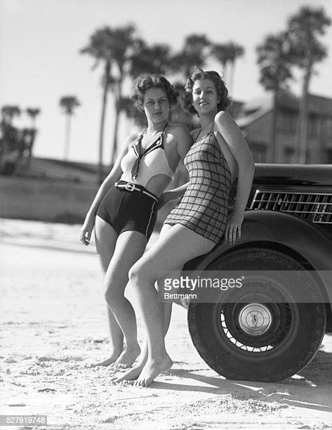 Photo shows two bathing girls leaning on an automobile Model Jean E Ellison and Jessica Jenkins Ca 1930s
