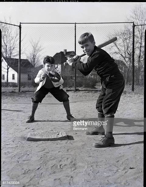 Photo shows two boys playing baseball, one at bat and one playing catch. Model: Samuel S. Walstrom, C. Byron Lear, Jr. Undated.