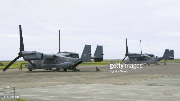 Photo shows two CV22 transport aircraft of the US Air Force at Amami airport in Kagoshima southwestern Japan on June 4 2018 after they made an...