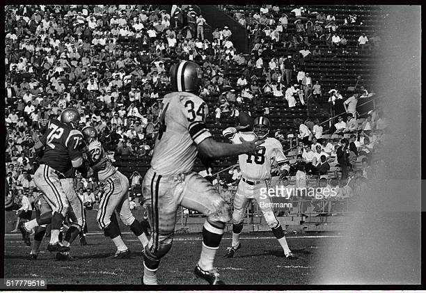 Photo shows two Ram teammates quarterback Roman Gabriel and halfback Lester Josephson team up to give the West 10 years in the third quarter on a...