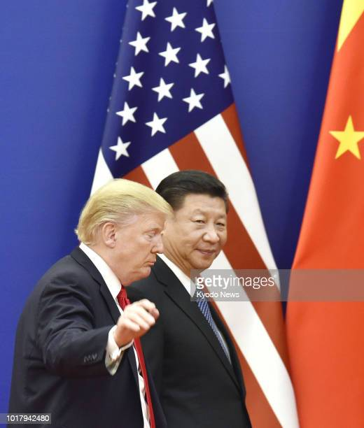 Photo shows US President Donald Trump and Chinese President Xi Jinping leaving after a signing ceremony at the Great Hall of the People in Beijing in...