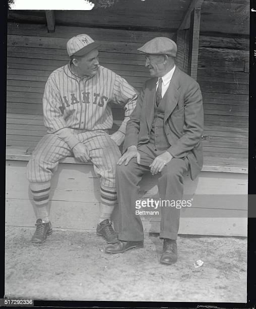 Photo shows William Ironson affectionately known to the sporting profession as Old Ironsides as he was snapped in earnest conversation at the Giants'...