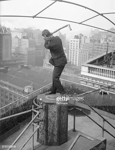 Photo shows Willie McFarlane the world open Golf Champ driving off the roof of the Hotel McAlpin with the club which was made for him by a crippled...